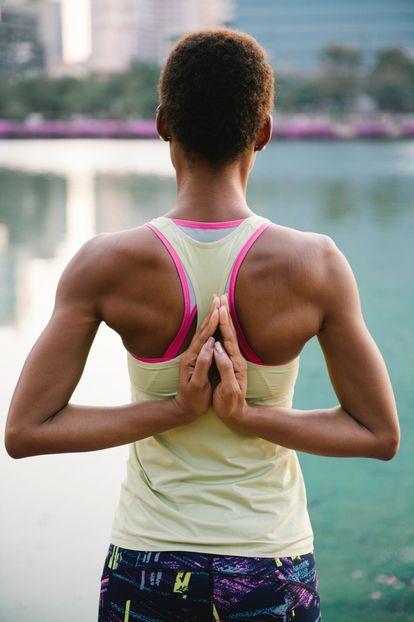 woman-doing-a-yoga-pose-hand-behind-back