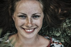 make a better workplace a girl smiling with freckles