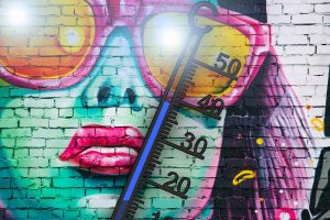 thermometer on the colourful graffiti
