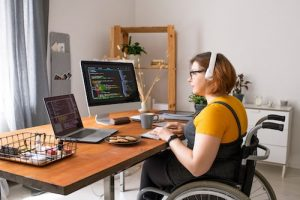 fitnest electric standing desk image of a disabled coder remote work for article fitnest electric standing desk image of a woman work remote on tropical beach for article i don't want to go back to work in the office
